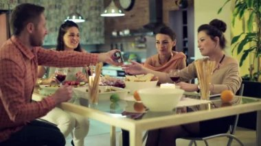 Friends looking at funny things on smartphone during dinner — Stok video