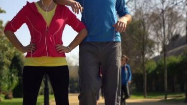 Happy joggers, couple standing in park — Stockvideo