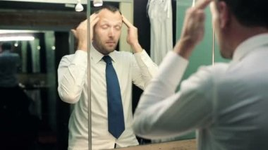Businessman preparing his hair in the bathroom — Stock Video