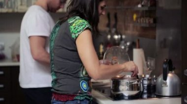 Young couple cooking meal in kitchen at home — Stock Video