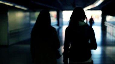 Silhouette of two women walking in tunnel — Stock Video
