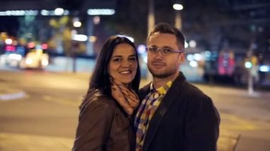 Happy young couple in love standing in the night by the street — Stock Video