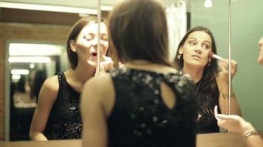 Elegant girlfriends doing makeup, preparing to party in bathroom — Stock Video
