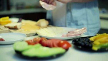Man preparing tasty breakfast on table in the kitchen — Stock Video