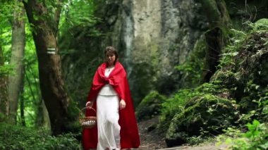 Mysterious red riding hood walking in forest — Stock Video