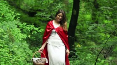 Happy Red riding hood with basket walking in forest — Stock Video