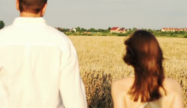 Couple in love walking in wheat field — Stock Video