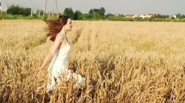 Young woman running on wheat field — Video Stock
