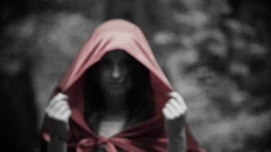 Mysterious beautiful woman, red riding hood in the forest — Stock Video