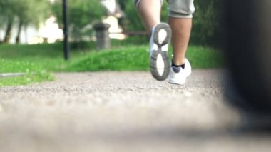 Joggers legs jogging on track in park — Stock Video