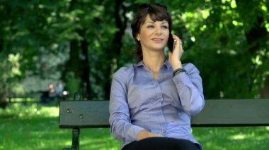 Businesswoman talking on cellphone — Stock Video