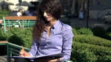 Attractive businesswoman working with documents — Стоковое видео