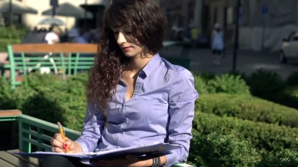 Attractive businesswoman working with documents — Vidéo