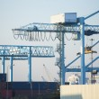 Shore crane loading containers in freight ship — Stock Photo #67630559
