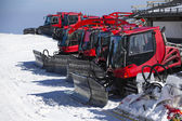 Group of Snow-grooming machine on snow hill ready for skiing slo — Stock Photo