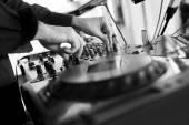 Dj mixes the track in the nightclub at party — Stock Photo