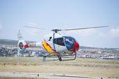 GRANADA,SPAIN - May 18: Aerobatic Spanish helicopter patrol (ASPA Patrol) perform at airshow (10 Aanniversary of Aspa Patrol in Granada) on May 18, 2014 in Granada ,Spain — Stock Photo
