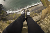 Legs hanging over a cliff — Stock Photo