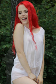 Red haired model in wet white cotton — Stock Photo