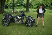 Cute model in tartan plaid skirt posing in front of a quad — Stock Photo