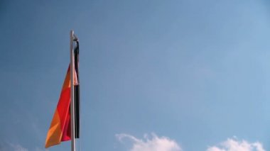 Germany flag in front of a blue sky — Stock Video