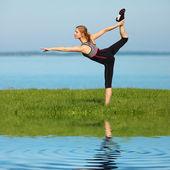 Beautiful girl doing yoga  — Stock Photo