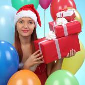 Christmas.smiling woman in santa helper hat with gift boxes — Stock Photo