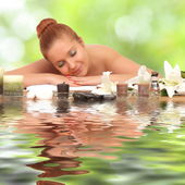 Young healthy girl relaxing in spa — Stock Photo