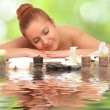 Young beautiful woman in spa environment. — Stock Photo #53632729
