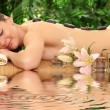 Young beautiful woman in spa environment. — Stock Photo #53633037