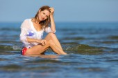 The beautiful blonde in the sea — Stock Photo
