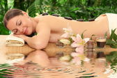young beautiful woman in spa environment. — Stock Photo