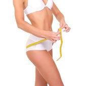 Woman with measure tape over white — Stockfoto