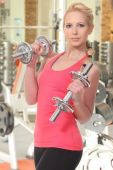 Attractive young woman  in fitness sport club — Stock Photo