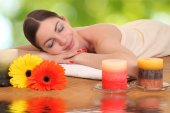 Young girl lying in a spa — Stock Photo