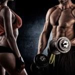 Closeup of a muscular young man lifting weights — Stock Photo #60600343