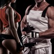 Strong Young Couple Working Out With Dumbbells - Shot In Studio — Stock Photo #60998009