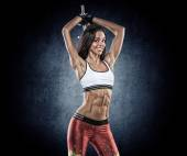 Sports young woman with dumbbells — Stock Photo