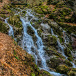 Cascade falls over mossy rocks in the Vitosha mountain — Stock Photo #57284679