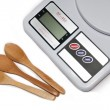 Digital kitchen scale and wooden spoons — Stock Photo #58254409