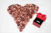Heart of stones with engagement ring — Stock Photo