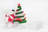 White teddy bear with christmas tree — Stock Photo