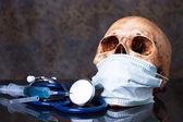 Stethoscope , syringe, human skull — Stock Photo