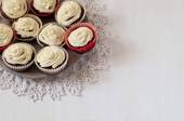 Cupcakes on lace  in the white table — Stock Photo