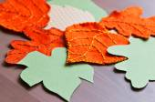 Pieces of felt and paper decoration in shape of autumn leaves — Stock Photo