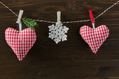 Homemade hearts with snowflake  on wooden backgraund — Stock Photo