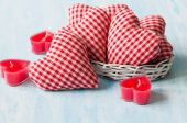 Homemade red hearts with candles on blue wooden backgraund — Stock Photo