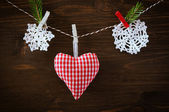 Homemade heart with snowflakes on wooden backgraund — Stock Photo