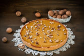 Walnut cake with pumpkin on wooden backgraund — Stock Photo