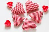 Red valentine's hearts with candes on white backgraunds — Stock Photo